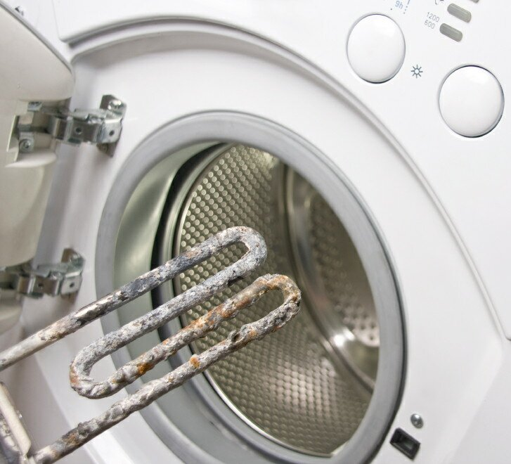 Washing machine and damaged electric heater